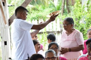 Sancharra's eldest son performing the Hindu rites.