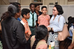 Mrs. Granger interacts with teachers and students from F. E. Pollard Primary School.