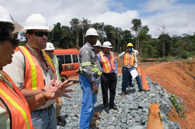 Minister Trotman observes operation at a mining pit at Karouni.