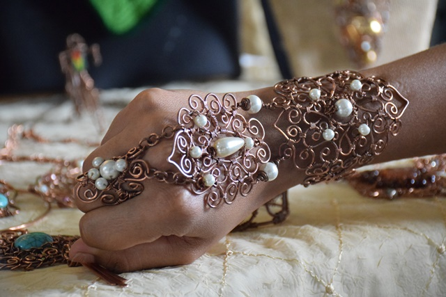 A copper wire wrapped slave bracelet made by Seleina's Craft and Things.
