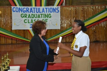 Reseda Hack, Bartica, Region Seven receiving her certificate from the Minister within the Ministry of Indigenous Peoples' Affairs, Valerie Garrido Lowe.