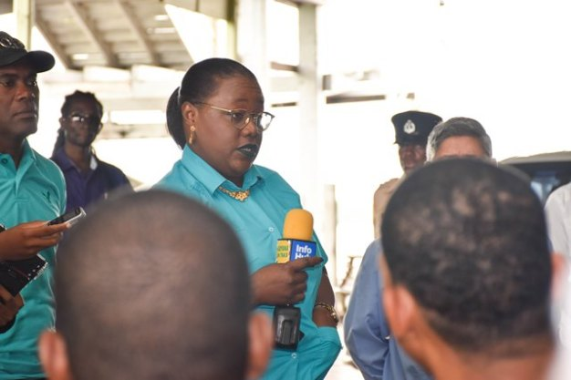 Minister within the Ministry of Natural Resources, Simona Broomes addressing workers at the New Amsterdam Stelling.