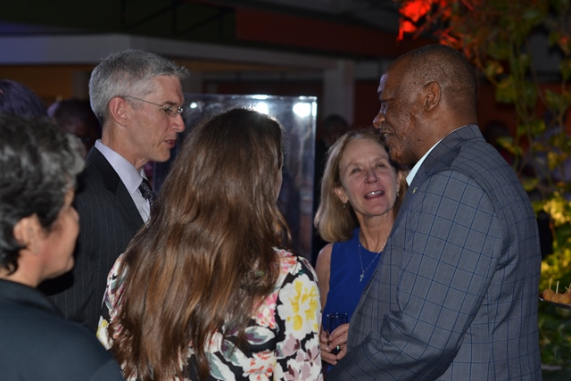 Minister of State, Joseph Harmon engaging Exxon's Country Manager, Rod Henson, while Exxon's VP Lisa Waters looks on.