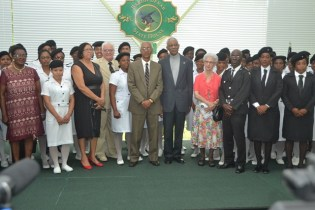 President David Granger poses with members of the St. John's Association of Guyana following the Thanksgiving Service.