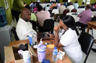 One of the teachers testing his blood pressure.