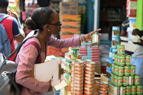 Chief Meat and Food Inspector (ag) Onica Alleyne-Blackman examining products at the Stabroek Market Bazaar.