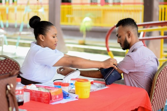 Occupational Therapist, Calvin Lawrie, who spearheaded the blood drive activity preparing to give blood.