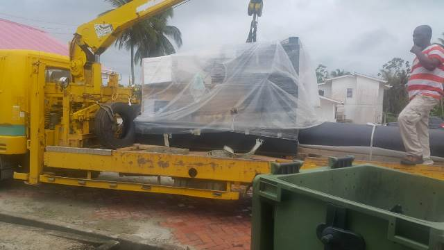 The new generator being offloaded at the Oscar Joseph Hospital.