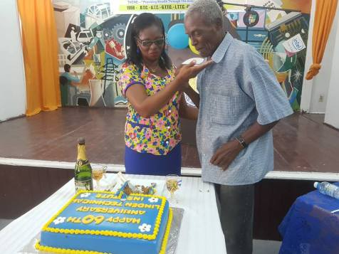 LTI Principal (ag) Shurla Brotherson cuts the 60th anniversary cake with Desmond Bacchus, student of the first batch