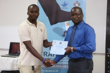 Mines Officer receiving his certificate.
