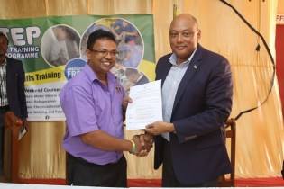 Minister of Natural Resources, Raphael Trotman and Manager of the GTCPM following the signing of the contract at the launch of IN-STEP.