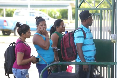 """Family members of Danesh Persaud called """"Vicky"""" and Mahese Sarjoo preparing to head to Suriname to observe the National Day of Mourning with a prayer service hosted by the Guyana Embassy in Paramaribo."""