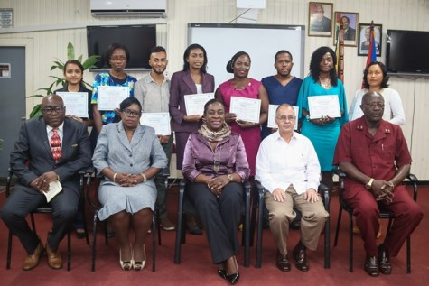 Minister of Education Nicolette Henry (centre) and Cuba's Ambassador to Guyana Narciso Socorro, with trainees of the new programme today.