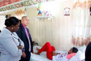 Minister of Education, Hon. Nicolette Henry and Minister of Social Cohesion, Hon. Dr. George Norton during their visit to the home of Beyonce Ross.