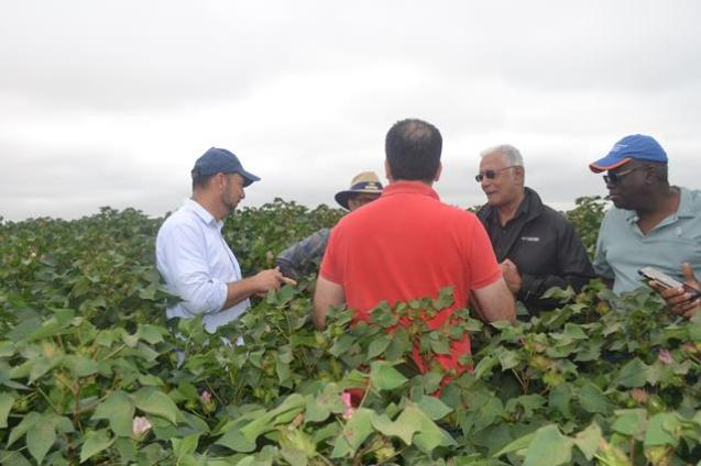 Minister Holder and other members of the team while on one of the farms.