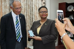 Minister Lawrence displaying the signature sfter signing the HCC petition.