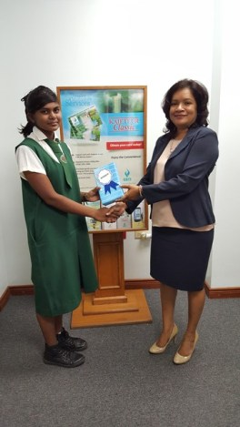 Ms Kavita Rohan,of Canal No 2 (1) receives her prize from GBTI's Vreed-En-Hoop Branch Manager Ms Nandanee Persaud.