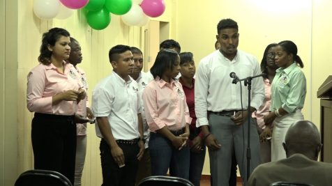 Co-op staff performing a special item during the service. Song/spoken word