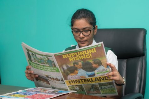 DPI's Director for the day, Devika Rajaram perusing the Rupununi Rising Publication.