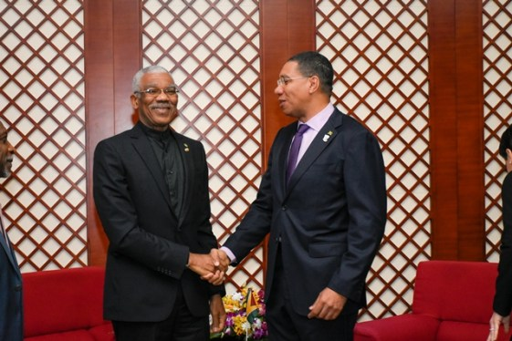 President David Granger greets Jamaican Prime Minister Andrew Holness before the meeting today.