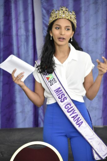 Miss World Guyana, Ms. Ambika Ramraj gestures as she delivers her address at the workshop
