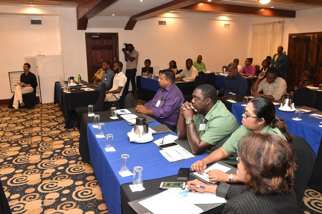 Participants of the GHG-I Workshop listen keenly to presentations made via Skype by Professor Amit Garg and Dr. Indu Murthy of India. 