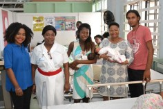 Minister Lawrence and GPHC staff with parents of one set of twins.