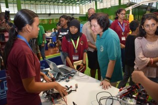 First Lady Sandra Granger views one of the robots on display at the exhibition.