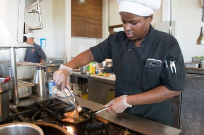 Chef at Guyana Marriott's Terra Mare Restaurant, Renee James prepares a meal in the kitchen