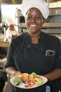 Chef at Guyana Marriott's Terra Mare Restaurant, Renee James poses with an appetizer she prepared. (Appetizer- jalepeno bombers and bacon shrimp wrap)
