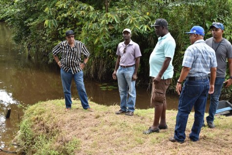 GWI Officials near the Kaituma River where mercury was discovered.