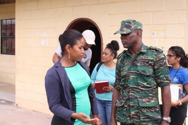 Lt. Col. Kester Craig in discussion with a representative from the community of Kwakwani