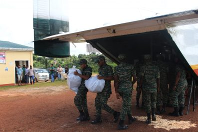 Soldiers offloading hampers