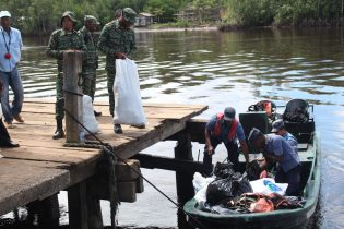 GDF Officers loading supplies in a boat to take to Powaikuru