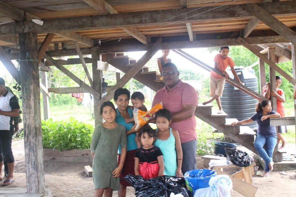 Regional Chairman, Region One, Brentnol Ashley with a Venezuelan family in Kamwatta