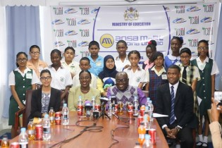 (From second Left) Minister of Education, Nicolette Henry, Chief Education Officer (CEO), Marcel Hutson and Brand Manager at Ansa Mcal, Errol Nelson flanked by the top NGSA students present at the ceremony this morning