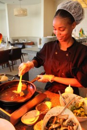 Trainee Chef at Guyana Marriott's Terra Mare Restaurant prepares a meal in the kitchen