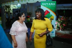 Mrs. Sita Nagamootoo and Minister within the Ministry of Public Health, Dr. Karen Cummings interact with each other at the reception.
