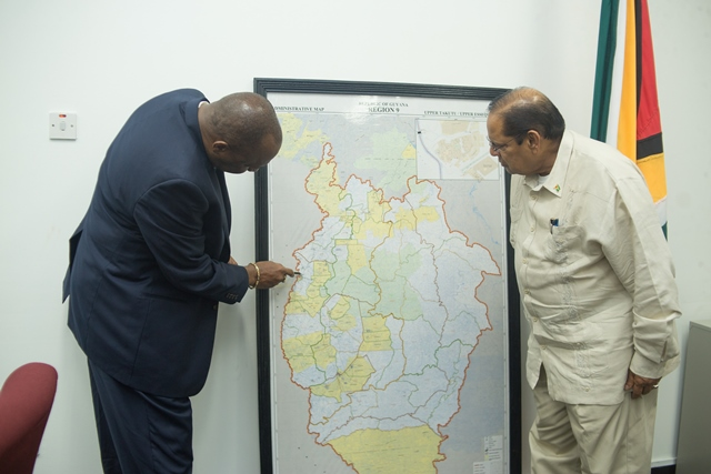Prime Minister Moses Nagamootoo and Minster of State Joseph Harmon identifying the areas that are affected.
