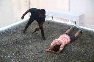 Local actors performing demonstrating an act of Human Trafficking