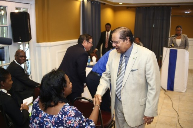 Prime Minister Moses Nagamootoo greets a member of the audience.