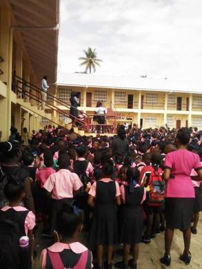 Students and teachers of One Mile Primary School during an outdoor assembly.