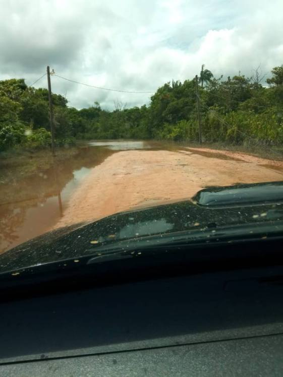 The access road visible after water has significantly receded