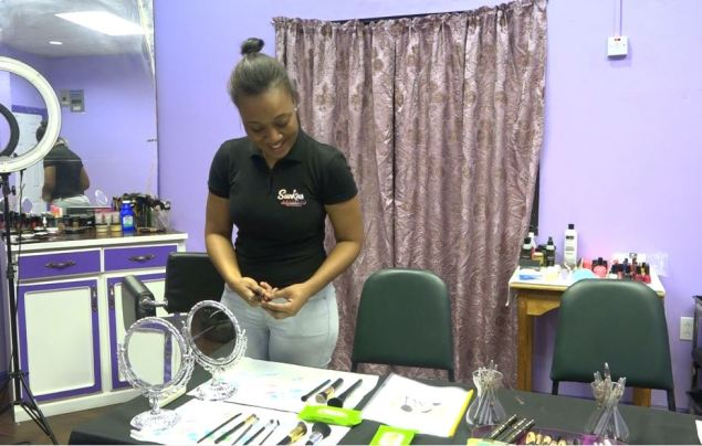 Makeup Artist and Owner of Sunkissed Artistry, Mosa Henry prepares for the next session of beginner's course makeup class.