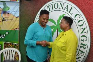 Minister of Public Health Volda Lawrence congratulates Minister within the Ministry of Public Infrastructure, Annette Ferguson on being eleceted First Vice-Chair of the PNCR