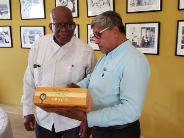 DDL Chairman Komal Samaroo shows Minister of Finance Winston Jordan the first of a new El Dorado GIft Pack containing El Dorado premium rums aged 12, 15, and 21 years in new 375ml bottles
