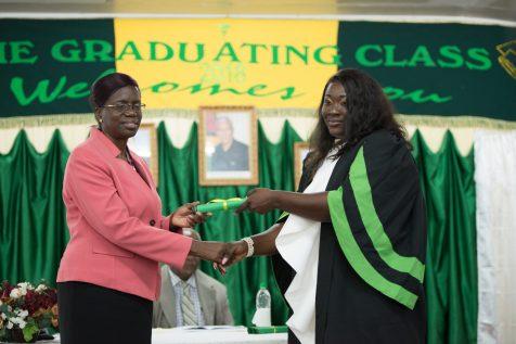 Derissa David receives a Certificate of Higher Credit from Permanent Secretary, Delma Nedd