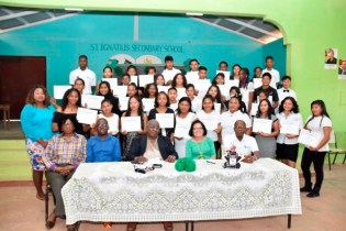 Mrs. Granger and facilitators posed with the newly certified graduates of the ICT workshop.