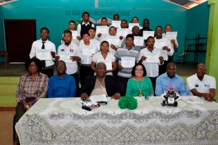 Mrs. Granger and facilitators posed with the graduates of the Heavy-Duty Equipment Operator Training Programme.