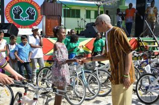 President David Granger handed over some bicycles to children in No.53/ Union Village.